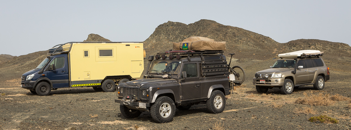Mine, Manuel's and Streaky's vehicles on a mountain top in Oman